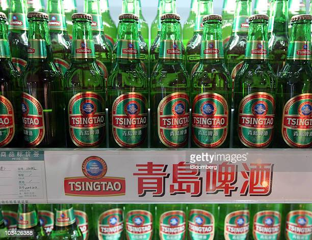 Bottles of beer are for sale at the Tsingtao Brewery Co museum in Qingdao China on Monday Aug 16 2010 Tsingtao Brewery Co is a Chinese beer company...