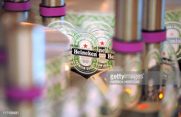 Bottles of beer are labelled at the production line of Dutch brewer Heineken factory on June 7 2011 in Schiltigheim eastern France during an official...