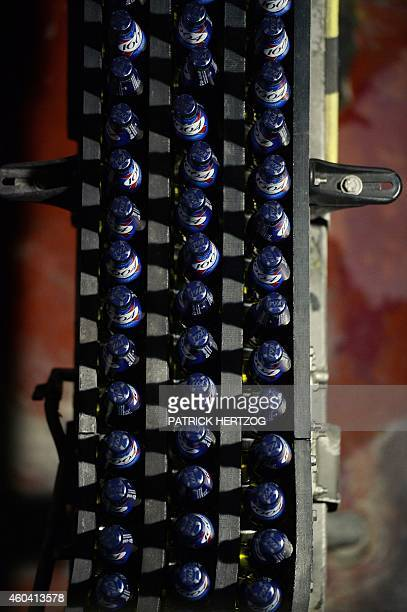 Bottles of beer are seen on the Kronenbourg brewer production line on December 12 2014 at the main factory in the eastern French city of Obernai AFP...