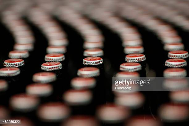 Bottles of beer move along the production line at the AnheuserBusch Budweiser bottling facility in St Louis Missouri US on Tuesday July 28 2015...