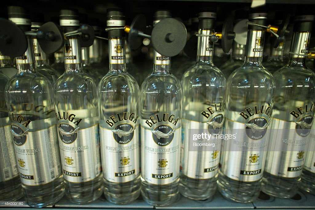 Bottles of Beluga vodka, produced by Synergy Group, sit for sale inside a Metro Cash & Carry store, the Russia unit of Metro AG, in Moscow, Russia, on Friday, Aug. 29, 2014. Metro Cash & Carry has warned that domestic food suppliers are trying to increase some food prices as local produce is substituted for EU, Norwegian and U.S. equivalents which have been sanctioned. Photographer: Andrey Rudakov/Bloomberg via Getty Images