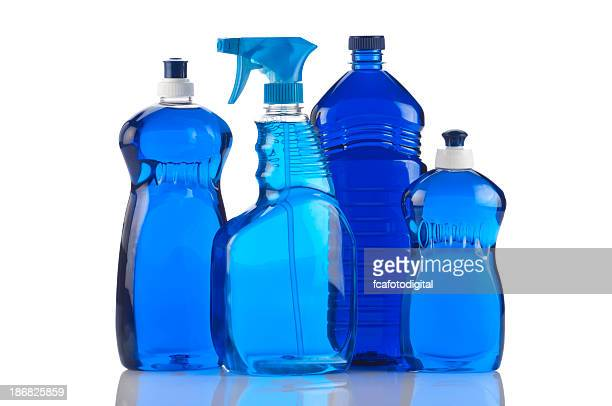 Bottles of blue cleaning products