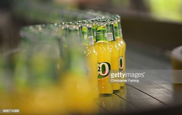Bottles of Britvic J2O soft drinks are displayed on the production line during a visit by Conservative Chancellor George Osborne on April 1 2015 in...
