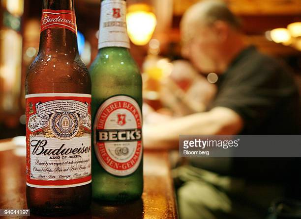 Bottles of Budweiser and Beck's beer are arranged in the Pig 'n' Whistle restaurant in New York on Monday June 4 2007 InBev NV the Belgian brewer...