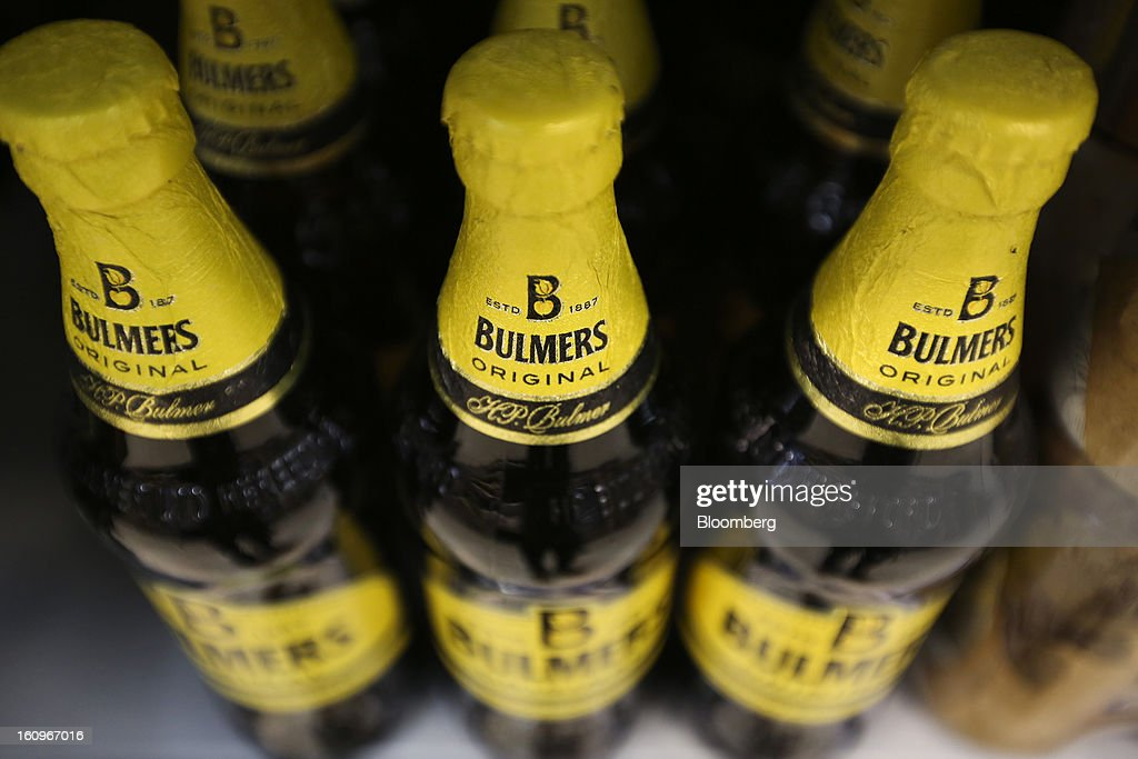 Bottles of Bulmers cider, produced by Heineken NV, sit on display inside a supermarket in London, U.K., on Friday, Feb. 8, 2013. Britain's economy will grow more slowly this year than previously forecast and stagnation may persist, according to the National Institute of Economic and Social Research. Photographer: Chris Ratcliffe/Bloomberg via Getty Images