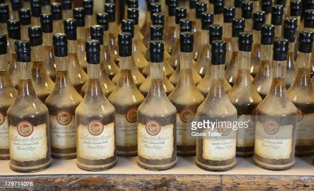 Bottles of Calvados are stored at the production facility of Calvados Morin in the Lower Normandy region on August 13 2013 in IvrylaBataille France...