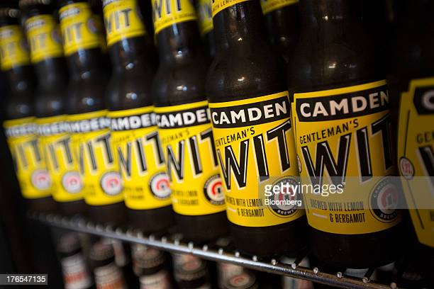 Bottles of Camden Town Brewery Co Gentleman's Wit lemonflavored craft beer sit inside a refrigerator in the company's brewery in London UK on...