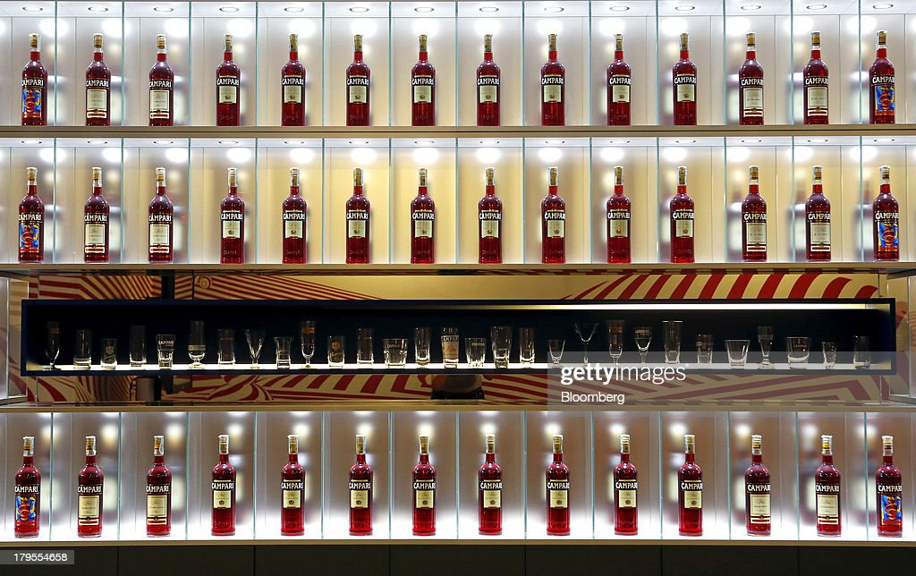 Bottles of Campari sit in an illuminated display case inside a gallery at the headquarters of Davide Campari-Milano SpA in Milan, Italy, on Wednesday, Sept. 4, 2013. Campari, the maker of Skyy vodka and Wild Turkey bourbon, said it expects gradual improvement for the rest of the year after sales trends improved for its leading liquor brands in the second quarter. Photographer: Alessia Pierdomenico/Bloomberg via Getty Images