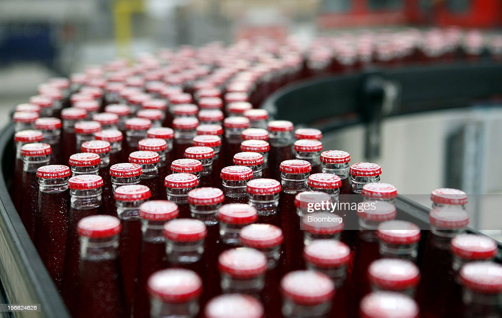 Bottles of Camparisoda, a single-serve aperitif, travel along the production line at Davide Campari-Milano SpA's factory in Novi Ligure, Italy, on Wednesday, Nov. 21, 2012. Business conditions in Italy, where Campari gets almost a third of annual revenue, are likely to remain volatile in the fourth quarter and early next year, Chief Executive Officer Bob Kunze-Concewitz said. Photographer: Alessia Pierdomenico/Bloomberg via Getty Images