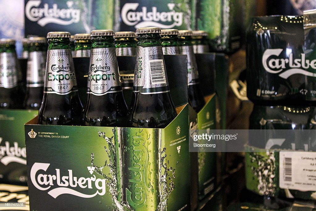 Bottles of Carlsberg Export beer stand on display at the company's store at the headquarters of Carlsberg A/S in Copenhagen, Denmark, on Thursday, Feb. 14, 2013. Danish brewer Carlsberg A/S owns France's biggest beer brand Kronenbourg. Photographer: Freya Ingrid Morales/Bloomberg via Getty Images