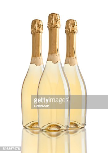 Bottles of champagne golden yellow color on white : Stock Photo