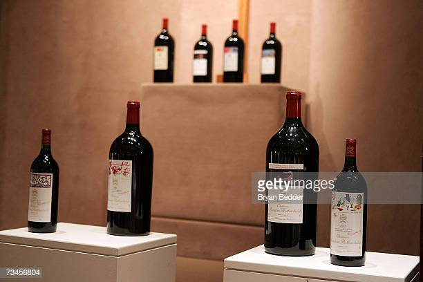 Bottles of Chateau Mouton Rothschild are on display during the Chateau Mouton Rothschild auction at Sotheby's auction house on February 28 2007 in...