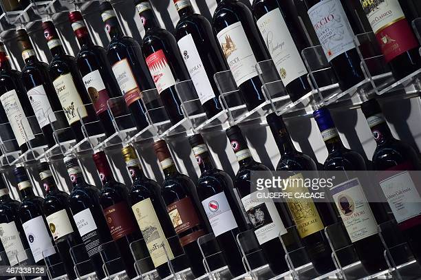 Bottles of Chianti wine are displayed on March 23 2015 at the Vinitaly exposition in Verona AFP PHOTO / GIUSEPPE CACACE