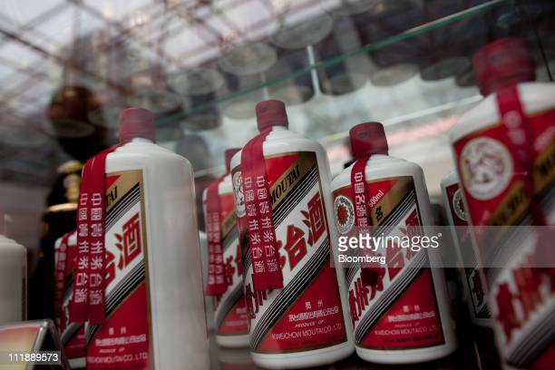 Bottles of China Kweichow Moutai Distillery Co baijiu liquor are displayed at the company's facility in the Maotai section of the Renhuai District in...