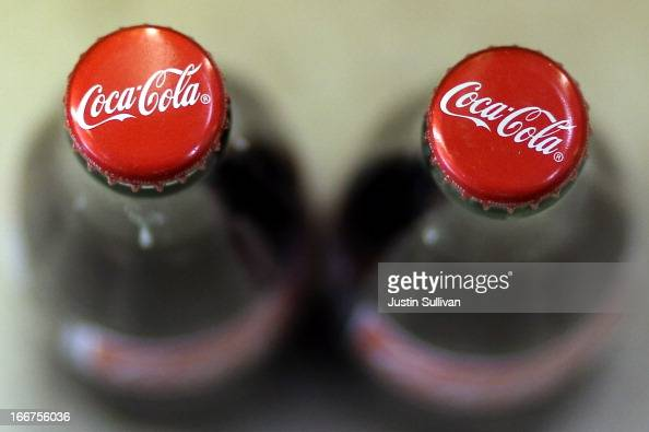 Bottles of Coca Cola are displayed at a market on April 16 2013 in San Francisco California Share prices of Coca Cola Co surged as much as 58% today...