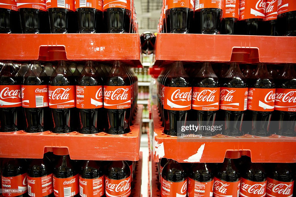Bottles of Coca Cola stand on display in a shopping aisle inside an ICA supermarket store in Stockholm, Sweden, on Tuesday, Feb. 19, 2013. Hakon Invest AB, the minority owner of Sweden's largest food retailer ICA, agreed to take full control by acquiring partner Royal Ahold NV's 60 percent stake for 20 billion kronor ($3.1 billion). Photographer: Casper Hedberg/Bloomberg via Getty Images