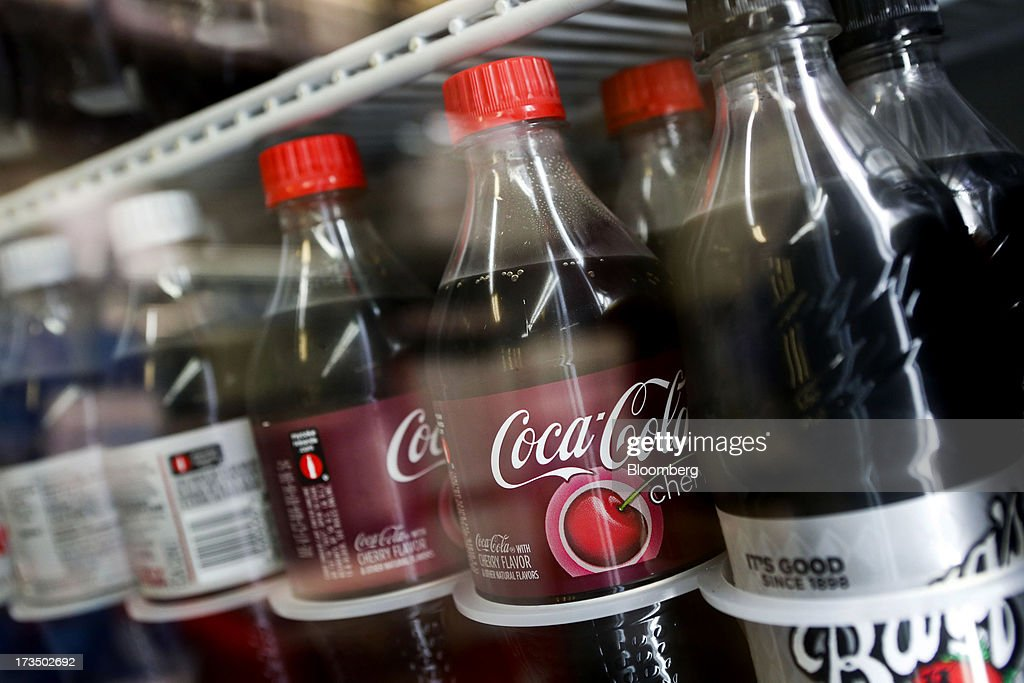 Bottles of Coca-Cola Co. brand soda are displayed for sale at a convenience store in Redondo Beach, California, U.S., on Monday, July 15, 2013. The Coca-Cola Co. is scheduled to release earnings data on July 16. Photographer: Patrick Fallon/Bloomberg via Getty Images