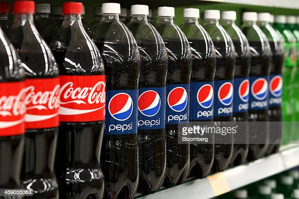 Bottles of CocaCola Co soda and PepsiCo Inc Pepsi soda are displayed for sale at an EMart Co store a subsidiary of Shinsegae Co in Incheon South...