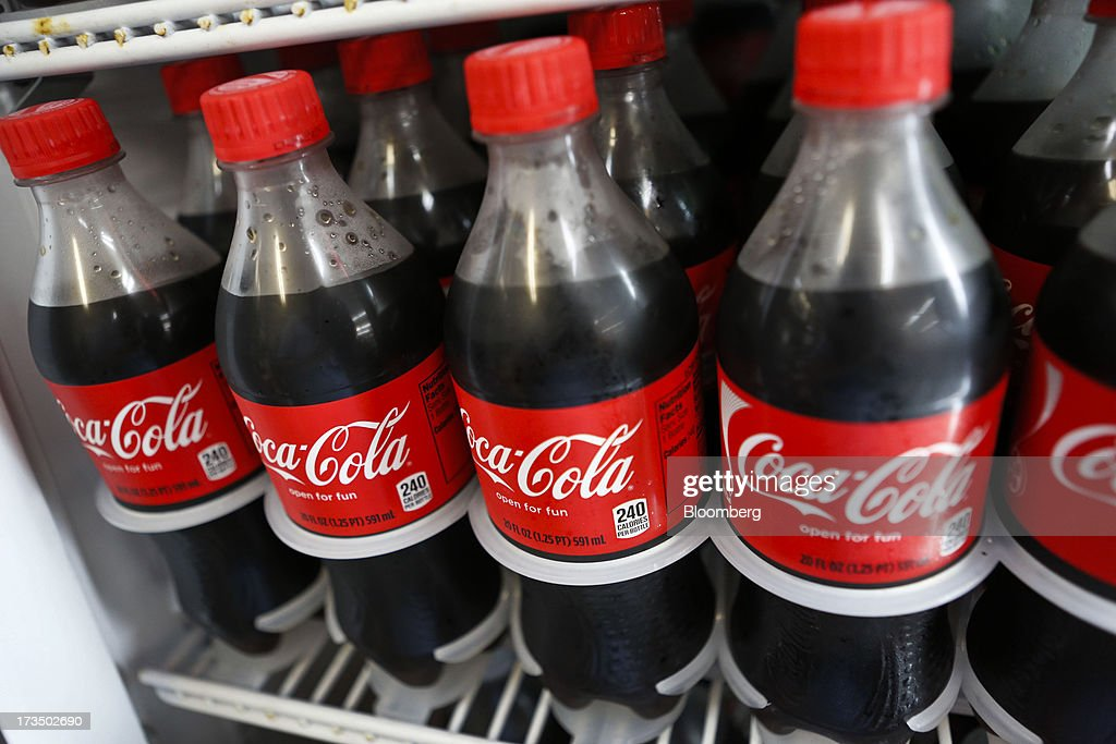 Bottles of Coca-Cola Co. soda are displayed for sale at a convenience store in Redondo Beach, California, U.S., on Monday, July 15, 2013. The Coca-Cola Co. is scheduled to release earnings data on July 16. Photographer: Patrick Fallon/Bloomberg via Getty Images