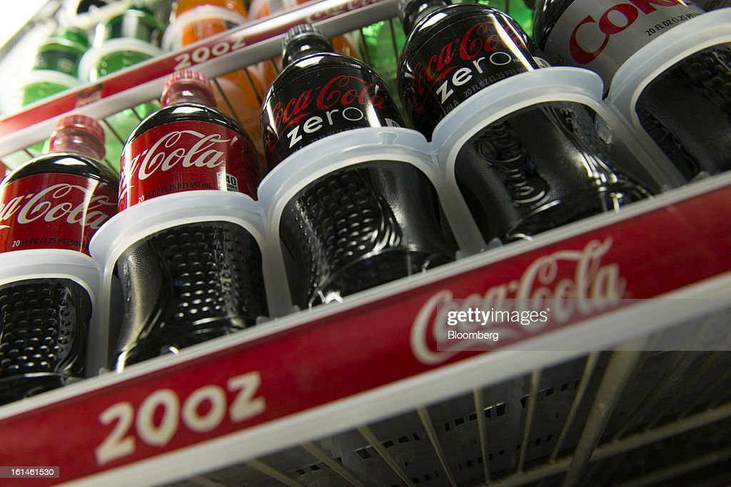 Bottles of Coca-Cola Co. soda products are displayed in a store in San Francisco, California, U.S., on Wednesday, Feb. 6, 2013. The Coca-Cola Co. is scheduled to release earnings data on Feb. 12. Photographer: David Paul Morris/Bloomberg via Getty Images