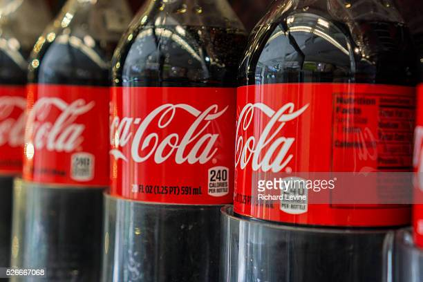 Bottles of CocaCola in a grocery store in New York on Tuesday April 1 2014 The CocaCola Co is scheduled to report its fourthquarter financials prior...