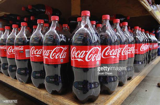 Bottles of CocaCola soda are offered for sale at a grocery store on April 17 2012 in Chicago Illinois The CocaCola Co reported an 8 percent increase...