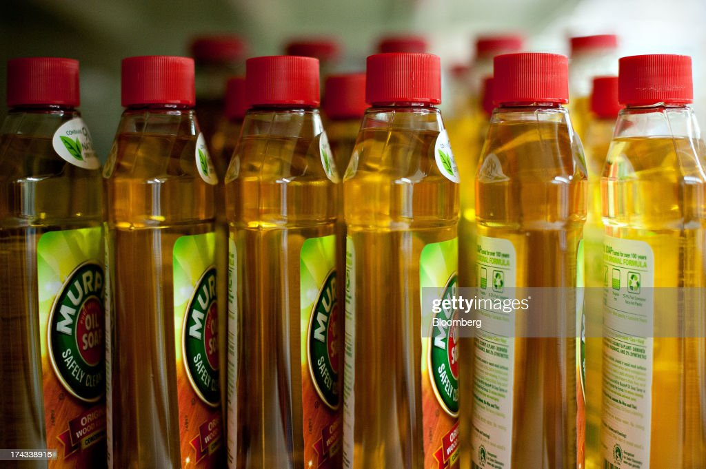 Bottles of Colgate-Palmolive Co. Murphy Oil Soap brand wood cleaner are displayed for sale on a supermarket shelf in Princeton, Illinois, U.S., on Tuesday, July 23, 2013. Colgate-Palmolive is scheduled to release second-quarter earnings on July 25. Photographer: Daniel Acker/Bloomberg via Getty Images