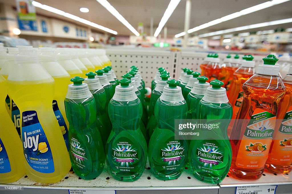 Bottles of Colgate-Palmolive Co. Palmolive brand dishwashing liquid, center and right, are displayed for sale on a supermarket shelf in Princeton, Illinois, U.S., on Tuesday, July 23, 2013. Colgate-Palmolive is scheduled to release second-quarter earnings on July 25. Photographer: Daniel Acker/Bloomberg via Getty Images