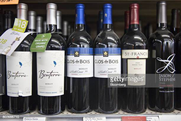 Bottles of Constellation Brands Inc Clos de Bois merlot wine center sit on display for sale at a liquor store in Ottawa Illinois US on Tuesday June...