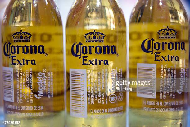 Bottles of Constellation Brands Inc Corona beer are arranged for a photograph at a bar in the Zona Rosa neighborhood in Mexico City Mexico on...