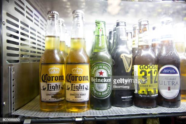 Bottles of Constellation Brands Inc Corona beer left sit in a cooler at a restaurant in Ottawa Illinois US on Tuesday June 27 2017 Constellation...