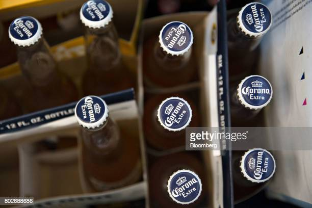 Bottles of Constellation Brands Inc Corona beer sit in a cooler at a restaurant in Ottawa Illinois US on Tuesday June 27 2017 Constellation Brands...