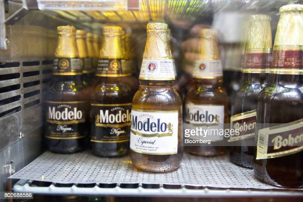 Bottles of Constellation Brands Inc Modelo beer sit in a cooler at a restaurant in Ottawa Illinois US on Tuesday June 27 2017 Constellation Brands...