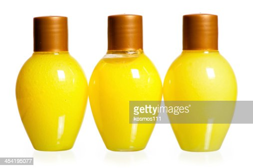 bottles of cosmetics on white background standing in a row : Stock Photo