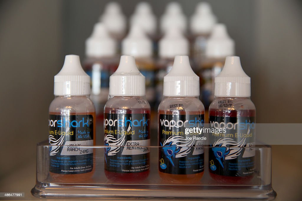 Bottles of different flavors of electronic cigarette liquid is seen at the Vapor Shark store on April 24, 2014 in Miami, Florida. Brandon Leidel, CEO, Director of Operations Vapor Shark, said he welcomes the annoucement by the Food and Drug Administration that they are proposing the first federal regulations on electronic cigarettes, which would ban sales of the popular devices to anyone under 18 and require makers to gain FDA approval for their products.