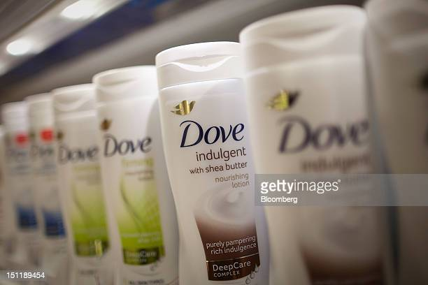 Bottles of Dove body lotion manufactured by Unilever NV are seen in a supermarket in Slough UK on Monday Sept 3 2012 UK retail samestore sales barely...