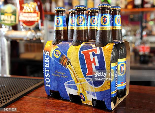 Bottles of Foster's beer sits on the bar at the Drop Bear Inn in South Melbourne on November 25 2011 Australia's government approved brewer...