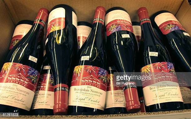 Bottles of French Beaujolais Nouveau are displayed at Holiday Market November 18 2004 in Royal Oak Michigan More Than 85000 bottles of the popular...