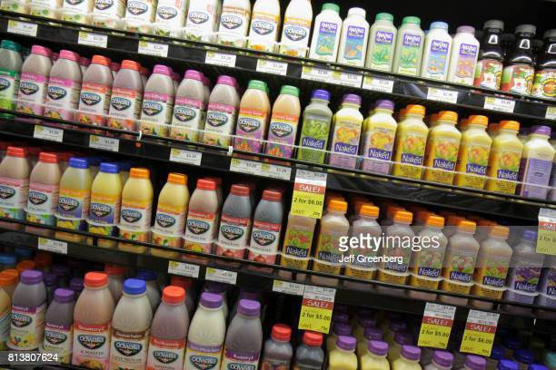 Bottles of fruit juice for sale at Whole Foods Market