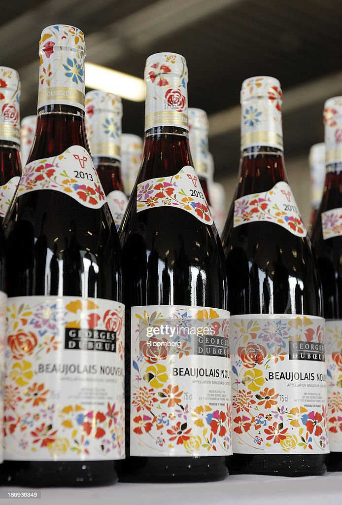 Bottles of Georges Duboeuf Beaujolais Nouveau wine sit at Haneda Airport in Tokyo, Japan, on Tuesday, Nov. 5, 2013. Japanese appetite for Beaujolais Nouveau has made the country the largest buyer of the young wine outside France, purchasing three times the U.S., the next biggest importer. Photographer: Akio Kon/Bloomberg via Getty Images