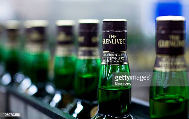 Bottles of Glenlivet whisky travel along a conveyor belt at the Pernod Ricard SA bottling plant in Paisley UK on Thursday Nov 18 2010 Pernod Ricard...