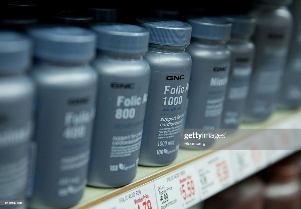 Bottles of GNC Holdings Inc. folic acid dietary supplement are displayed for sale at a store in New York, U.S., on Thursday, Feb. 14, 2013. GNC Holdings Inc., a retailer of health and wellness products, reported revenue increases of 10.9% in the fourth quarter and 17.3% for the full year. Photographer: Jin Lee/Bloomberg via Getty Images