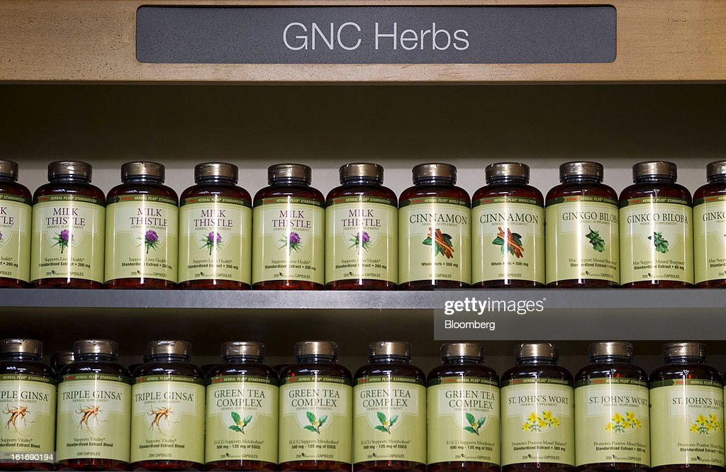Bottles of GNC Holdings Inc. herbal supplements are displayed for sale at a store in New York, U.S., on Thursday, Feb. 14, 2013. GNC Holdings Inc., a retailer of health and wellness products, reported revenue increases of 10.9% in the fourth quarter and 17.3% for the full year. Photographer: Jin Lee/Bloomberg via Getty Images