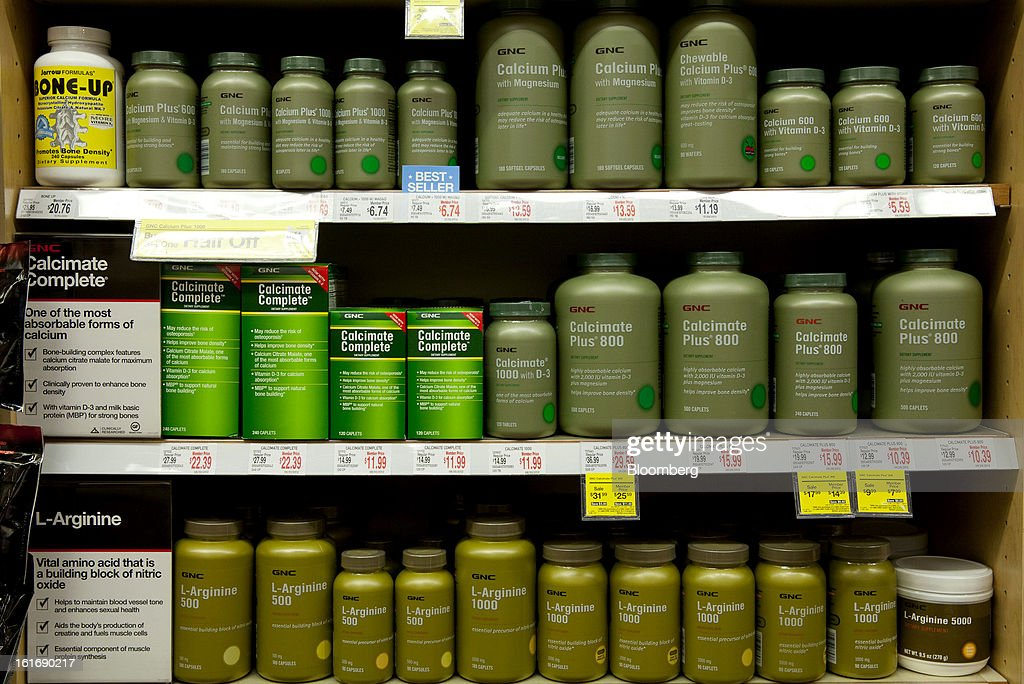 Bottles of GNC Holdings Inc. vitamin bottles are displayed for sale at a store in New York, U.S., on Thursday, Feb. 14, 2013. GNC Holdings Inc., a retailer of health and wellness products, reported revenue increases of 10.9% in the fourth quarter and 17.3% for the full year. Photographer: Jin Lee/Bloomberg via Getty Images