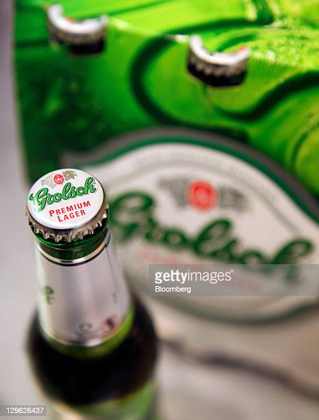 Bottles of Grolsch beer produced by SABMiller Plc are arranged for a photograph in London UK on Tuesday Oct 18 2011 UK shopprice growth was unchanged...
