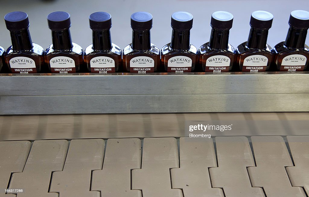 Bottles of imitation rum extract move along a conveyor at the J.R. Watkins production facility in Winona, Minnesota, U.S., on Thursday, March 21, 2013. Watkins Inc., founded in 1868, is a manufacturer of health remedies, baking products, and other household items. Photographer: Ariana Lindquist/Bloomberg via Getty Images