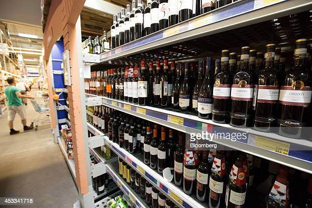 Bottles of imported European wines sit for sale inside a supermarket in Moscow Russia on Friday Aug 8 2014 Russia's President Vladimir Putin decreed...