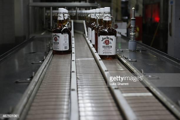 Bottles of Jim Beam Bourbon make their way down a conveyor belt inside the bottling plant at the Jim Beam Bourbon Distillery on January 13 2014 in...