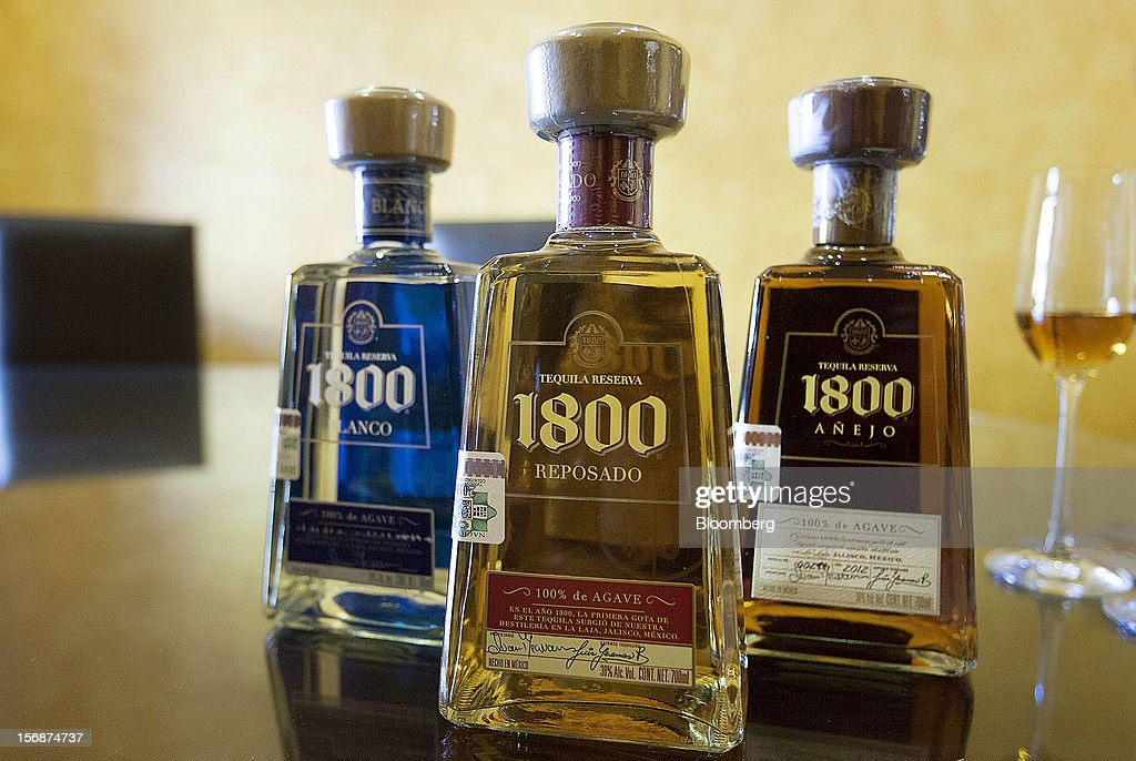 Bottles of Jose Cuervo 1800 are arranged for a photograph at the Tequila Cuervo La Rojena S.A. de C.V. distillery plant in Guadalajara, Mexico, on Thursday, Nov. 22 2012. There are more than 200 types of agave in Mexico, but use of the blue agave plant was made compulsory in the last century to the issuance of the Official Mexican Standard for Tequila production. Photographer: Susana Gonzalez/Bloomberg via Getty Images