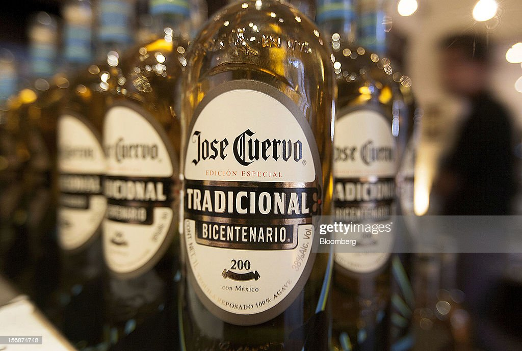 Bottles of Jose Cuervo Tradicional are arranged for a photograph at the Tequila Cuervo La Rojena S.A. de C.V. distillery plant in Guadalajara, Mexico, on Thursday, Nov. 22 2012. There are more than 200 types of agave in Mexico, but use of the blue agave plant was made compulsory in the last century to the issuance of the Official Mexican Standard for Tequila production. Photographer: Susana Gonzalez/Bloomberg via Getty Images